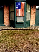 An American flag draps over a window of a rest station in a wilderness park. USA