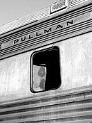 The top half of an old pullman train car is captured in black and white