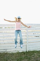 Girl jumping from a fence (thumbnail)