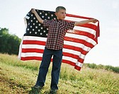 Boy holding an American flag (thumbnail)