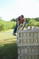 Boy on top of a crate (thumbnail)