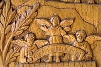 Religious scene carved in the wood of the doors of the Church of San Pietro e Paolo, Pescasseroli. L´Aquila, Abruzzo, Italy