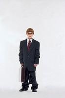 Boy in oversized business suit, portrait.