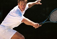 Man playing tennis.