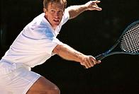 Man playing tennis.