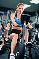 Woman on exercise machine.