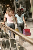 Teenagers with shopping bags.
