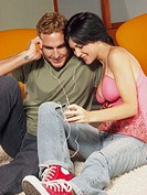 young couple listening music