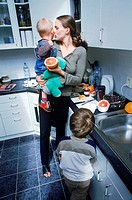 Mother with her children in the kitchen (thumbnail)