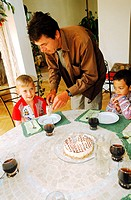 Man serving children cake on the table (thumbnail)