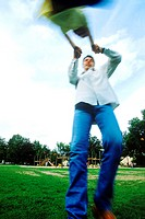 Blurred low angle view of a man swinging a child by the arms
