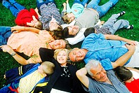 High angle view of a family lying on grass
