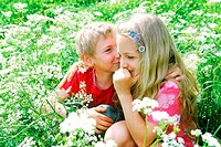 Boy and girl sitting in the grass (thumbnail)