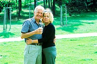 Portrait of mature couple standing in a garden