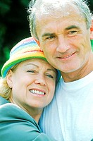 Portrait of mature couple smiling