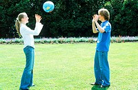Young couple playing with a ball in a garden (thumbnail)