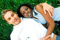 Portrait of a young couple lying on the grass (thumbnail)
