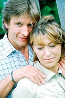 Portrait of couple holding each other (thumbnail)
