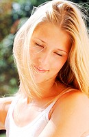 Young woman smiling with eyes closed (thumbnail)