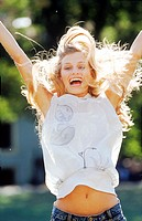 Close-up of a woman jumping with excitement (thumbnail)
