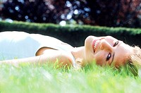 Young woman lying down on grass (thumbnail)