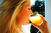Young woman drinking a glass of juice