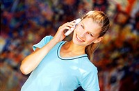 Young women talking on a mobile phone (thumbnail)