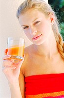 Young woman holding a glass of juice