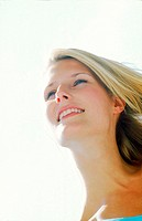 Low angle view of a young woman smiling (thumbnail)
