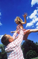 Father holding child in air