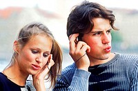 Young couple sharing headphones