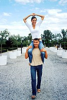 Young woman riding on young mans shoulders (thumbnail)