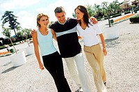 Young man walking with two young women (thumbnail)