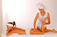 Young woman getting a massage by a woman