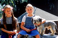 Portrait of two girls with their dog (thumbnail)