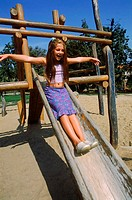 Girl sliding in a playground
