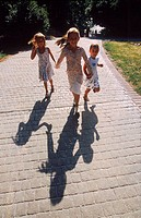 Three young girls running