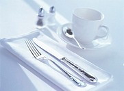 Close Up of a Knife Fork and Tea Cup