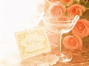 Close Up of a Wine Glass and Roses