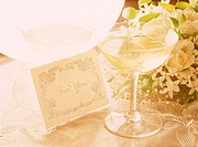 Close Up of Wineglass and Bouquet of Flowers (thumbnail)