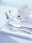 Close Up of Knife Fork Tea Cup and Saucer (thumbnail)