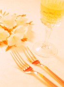 Close Up of Two Forks Wineglass and Flowers