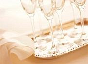 Close Up of Stemmed Wineglasses on Serving Tray