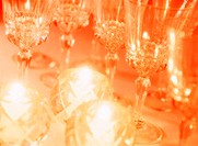Close Up of Stemmed Wineglasses and Candles