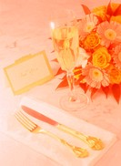 Close Up of Place Setting on Table with Flowers