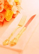 Cloe Up of a Knife and Fork on Napkin with Roses