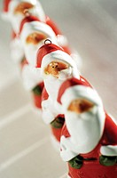Close-up of a row of Santa Claus figurines