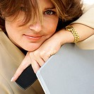 Close-up of a businesswoman leaning on a laptop