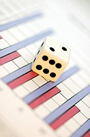Close-up of a dice on a bargraph