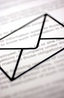 Close-up of an envelope sign over a document